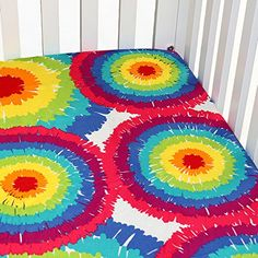 """#manythings Be one of a kind with our bold and beautiful collection """" #Terrific Tie Dye"""". Crib sheet in the collections tie dye cotton fabric."""
