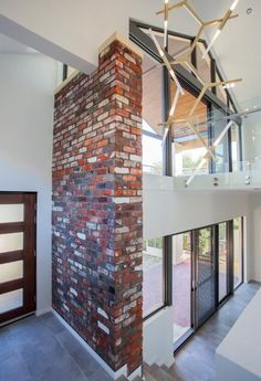 Innova Builders, recycled red brick wall with charcoal grey render, agnes cascade chandelier 20 globe Recycled Brick, Red Brick Walls, Red Bricks, Perth, Future House, Man Cave, Facade, Globe, Charcoal