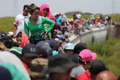Central American immigrants ride north on top of a freight train near Juchitlan, Mexico, on August 6, 2013. (John Moore/Getty Images)