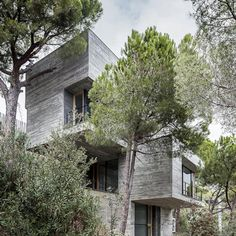 House by architect Daniel Isern that looks like a cluster of concrete cubes, stacked up on a steep hillside on the outskirts of Barcelona..