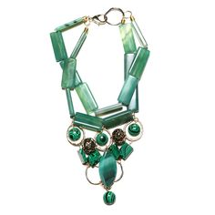 Geometric necklace with green semi-precious stones and gold tone metal elements