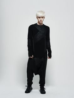 Assymmetrical texture coated knit sweater by Byungmun Seo