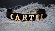 Finish off your look with this CARTEL super cute Letter Choker necklace.Take your outfit to the next level with this black wooden choker. * Length: 30 cm * Width: 2 cm * Chain link whit lobster clasp * Letters material: wood * Band material: elastic Available in black,red and white color