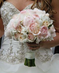 full and voluptuous bouquet of delicious fresh Peonies, English Garden Roses, Ranuculas, Hydrangeas and Sweet Peas, we'd finished off the handle with a pearl encrusted satin band to compliment the detail on Louise's exquisite gown