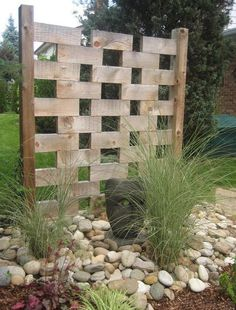 a litle bit of privacy with an artistic flare #landscapingandoutdoorspaces #landscapingprojects #PrivacyLandscape