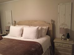 ASCP painted bedroom suit. From knotty pine to French country. Old closed doors painted and stenciled.  Still a work in progress. Furniture:  country grey base, coco wash, and pure white.
