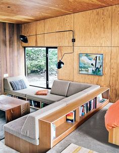 plywood walls and built-in seating in modern cabin / sfgirlbybay