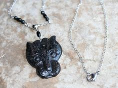 Black Panther, the symbol for deliberate movement & intention, brings the energy of awareness, patience, strength, stamina, divine timing, keen observation & wise use of time & energy. It will aid you in shedding that which needs to be let go & harnessing your inner power, so you are in full command of yourself & your resources. Made with Black Jasper, Black Obsidian & Astrophyllite.