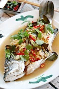 Steamed Wild Sea Bass With Lemongrass And Ginger (Ikan Siakap Stim) asian cooking Fish Recipes, Seafood Recipes, Asian Recipes, Cooking Recipes, Healthy Recipes, Kebab Recipes, Thai Recipes, Fish Dishes, Seafood Dishes