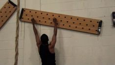 The climbing pegboard has become popular ever since introduced by Dave Castro at the CrossFit Games. Although they aren't too expensive to buy, they're even cheaper to make. Here's how to make your own DIY Climbing Pegboard. Parkour Equipment, Diy Gym Equipment, No Equipment Workout, Fitness Equipment, Home Gym Garage, Diy Home Gym, Basement Gym, Diy Peg Board, Peg Boards