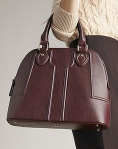 Structured dome satchel with sophisticated raised quilting in oxblood