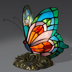 Butterfly | Tiffany style bedside lamp with hand worked and welded glass lampshade and bronze color resin base