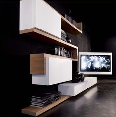 TV Rack cleverly combines media storage and a rotating TV stand into one sleek unit. The composition can be customized in a variety of sizes and finishes. Tv Wall Design, Tv Unit Design, House Design, Tv Furniture, Furniture Design, Italian Furniture, Muebles Rack Tv, Wall Tv Stand, Tv Rack