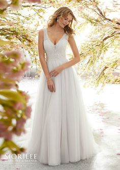 Dreamy English Net Wedding Gown Featuring a Deep V-Neckline Accented with Cross-Stitch Embroidery and Beading. The Deep V, Open Back adds a Touch of Sexy. Stunning Wedding Dresses, Wedding Dresses 2018, Wedding Dress Styles, Wedding Attire, Mori Lee Bridal, Mori Lee Wedding Dress, Net Gowns, Madeline Gardner, Vineyard Wedding