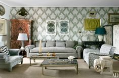Castillo accented the drawing room with a wallpaper from his collection for Gastón y Daniela; the vintage cabinet-on-chest is by Pierre Lottier. The Castillo-designed armchair at left is clad in a Designers Guild velvet, 1970s patchworks are displayed above the suede sofa, and the vintage cocktail tables were found at Paris's Marché Paul Bert.