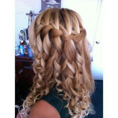 Horizontal half french braid with curls.