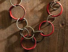enameled steel wire rings in Ring of Fire by Barbara Lewis - from Alternative Wire Jewelry Making: Hardware-Store Steel Wire Jewelry and Making Steel Wire Tools - Jewelry Making Daily