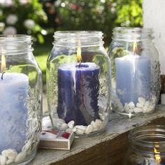 Fill old vases with small pebbles and large candles ! Nice summer table decor !