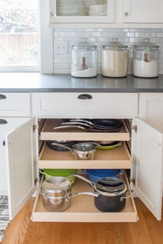 Major kitchen trouble spots are organized with custom glide out shelving from Kitchen Paint, Kitchen Backsplash, New Kitchen, Kitchen Decor, Kitchen Design, Custom Kitchen Cabinets, Kitchen Cupboard, Cheap Kitchen, Kitchen Appliance Storage