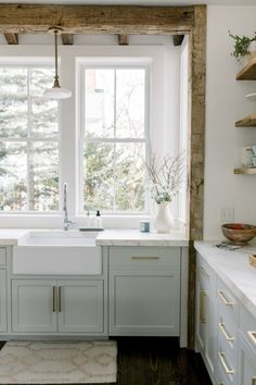 Timeless Tranquil White & Grey Kitchen Tour Elegant white farmhouse kitchen with Benjamin Moore Repose Grey cabinets, subway tile, gold accents, and reclaimed barn wood. Wood Interior Design, Home Interior, Interior Design Inspiration, Kitchen Interior, New Kitchen, Wood Design, Kitchen Ideas, Kitchen Box, Coastal Interior