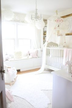 White Nursery - who wouldn't want this adorable angel wings decor?!