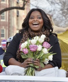 Jubilant: Octavia Spencer, 46, cheerfully accepted honors fromHarvard University's Hasty Pudding Theatricals Thursday