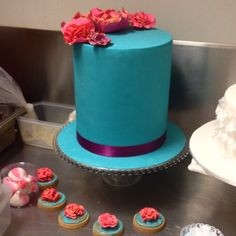Tall teal wedding cake for bridal expo