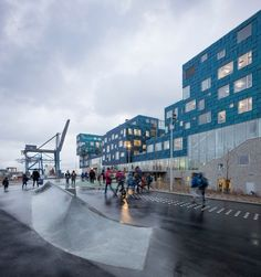 Blue-tinged solar panels almost completely cover this school that Scandinavian firm CF Møller has completed on Copenhagen's waterfront, providing half of the electricity needed to power the building.