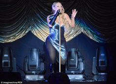 She's got it covered: This time around, Mariah covered her legs in black tights and black knee-high boots