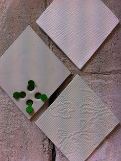 Diamond shaped tex-tiles. On one tile felt is added by Geanne Welles. #diamonshape #diamond #triangle #tiles #pastel #design #bathroom #textiles #transparant #white #translucent #porcelain #textiles #wall #decoration #led #imprint #relief #barbaravos #wallcovering #kitchen #shower #home #interior #design #glaze #backsplash #flower #pattern #coral #fabric #lace #texture