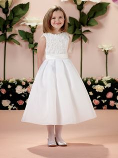 First Communion dresses in the Joan Calabrese Collection by Mon Cheri are available in ball gown, fit and flare, or A-line dress styles. Featuring traditional white dresses with sleeveless or short-sleeved options.