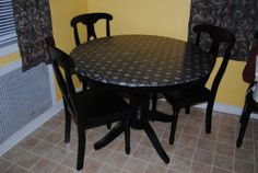 DIY Kitchen Table Re-surfacing using fabric, Mod Podge and a clear sealer.