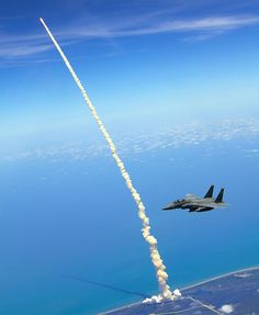 """Birds Eye View of Shuttle Launch  """"Lt. Col. Gabriel Green and Capt. Zachary Bartoe patrol the airspace in an F-15E Strike Eagle as the Space Shuttle #Atlantis launches May 14, 2010, at Kennedy Space Center, Fla. Colonel Green is the 333rd Fighter Squadron commander and Captain Bartoe is a 333rd FS weapons system officer. Both aircrew members are assigned to Seymour Johnson Air Force Base, N.C. (U.S. Air Force photo/Capt. John Peltier)"""""""