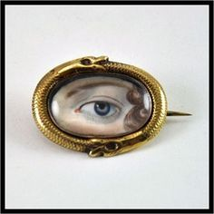An ouroboros Lover's Eye pin. Is there a better way to depict a secret and eternal love? Learn more about these captivating pieces of jewelry here http://www.jewelrynerd.org/blog.html