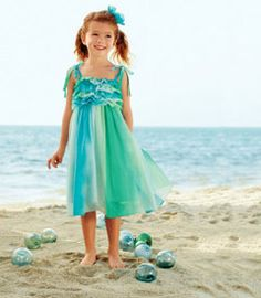 watercolor dress - Light as a sea breeze, this dress is a delight. The colors of the sea are captured in soft chiffon, and the shirred bodice is topped with ruffles. The straps tie at the shoulders, and the dress is lined.