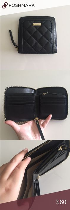 Authentic Kate Spade wallet Great used condition. Classic quilted wallet. Roomy and functional. Some stain flaws shown in the last three pics, not noticeable at all when in use. 100% authentic. kate spade Bags Wallets