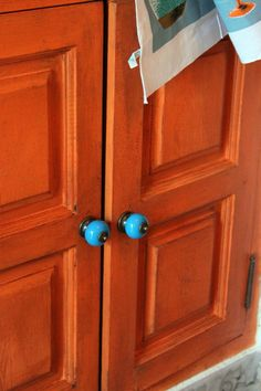 Annie Sloan chalk painted in Barcelona Orange on the cupboard doors in the…