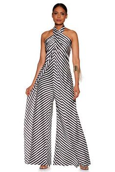 A crisscross halter neckline cascades down to dramatic split wide legs on our super sexy stripe jumpsuit. Short length lining. Double hook-and-eye neck closur Stylish Clothes For Women, Stylish Outfits, How To Wear Scarves, Party Dresses For Women, Jumpsuits For Women, Types Of Fashion Styles, Look Fashion, Street Style Women, Dress To Impress