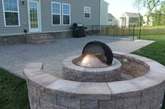 Ep Henry paver patio in Harvest Blend with Harvest Blend sitting wall and Firepit by Blue Moon