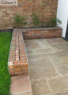 brick filled gabion wall http://www.gabion1.co.uk  Surely it's just a wall with a trim. Rubbish.