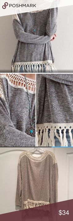 NWOT Boho Fringe Top Purchased on Posh New asa boutique item but came with out tags. Never wore it though. Higher in front than back. Super cute Boho Fringe. Last pic shows true color. Tops