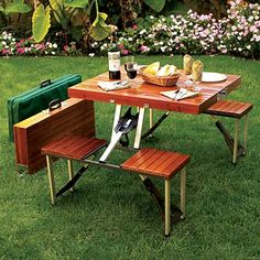 "Lightweight, easy to set up and carry, this attractive wooden folding picnic table is always ready to go. Constructed with a strong aluminum alloy frame and hardwood slats, it can easily accommodate four adults; measures 26""H x 33""W x 54""D when open. Picnic table folds for easy storage to a mere 14""H x 33""W x 4½""D, weighs just 21 lbs., and comes in a green nylon carrying case. Great for outdoor events, camping, or the backyard. 800 lbs. capacity."