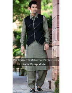 Superlative Jacket Pattern Pathani Suit Item code : SKB2035B   http://www.bharatplaza.in/ready-to-ship/kurta-pyjamas/superlative-jacket-pattern-pathani-suit-skb2035b.html   The design of this pathani suit is giving a creative look with accent of exclusivity. Grayish beige color kurta collar, cuffs and black jacquard jacket is enhanced with intricate decorative piping work. Paired with matching bottom. Best choice for those looking for a magnificent yet sober kurta pyjama.