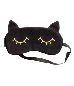 Black/gold-colored. Padded sleep mask in cotton jersey with embroidery and a…