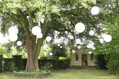 White nylon outdoor lanterns create this beautiful 'Secret Garden' style wedding!