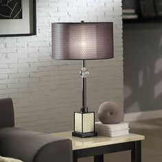 @Overstock - Lacey Black Chrome Table Lamp - Perfect in any den, family room or bedroom, the lacey lamps turn your room into a warm, inviting space. The metal base offers a graceful and timeless design.     http://www.overstock.com/Home-Garden/Lacey-Black-Chrome-Table-Lamp/7574118/product.html?CID=214117  $111.99