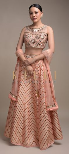 Buy Online from the link below. We ship worldwide (Free Shipping over US$100)  Click Anywhere to Tag Jovial Peach Lehenga Choli In Silk With Foil Applique And Mirror Abla Work Online - Kalki Fashion Jovial peach lehenga choli in silk adorned with foil applique in chevron pattern.Further adorned with mirror abla, zari and cut dana embroidered geometric pattern all over.