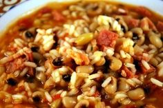 Hoppin' John, Emeril Lagasse... A new Year's tradition.  I leave the rice out and serve with cornbread.  YUMMY