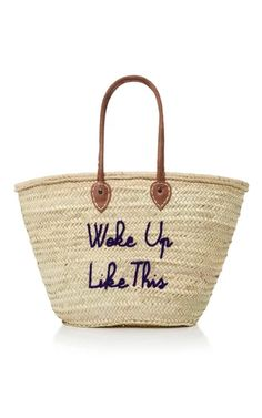 Poolside creates handmade straw totes emblazoned with irreverent pop cultural phrases. Trimmed with brown leather top handles, this 'Shorty' style is embroidered with 'Rose All Day' across the front in pink thread. Stow a towel, magazine and sunscreen in the spacious interior.