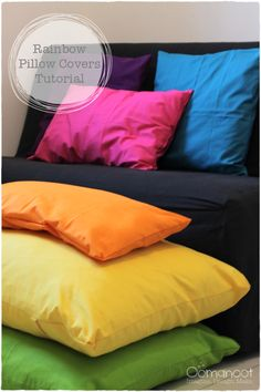DIY inspiration for stacking rainbow pillows for fort-building or cozy reading nook  (Oomanoot)